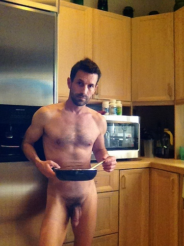 sexy naked man cooking